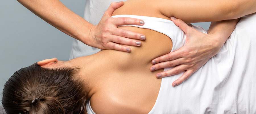 Osteopath giving treatment